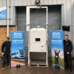 Acres Engineering Cooling Cabinet, photographed with two team members and Acres Creative Engineered banners either side.